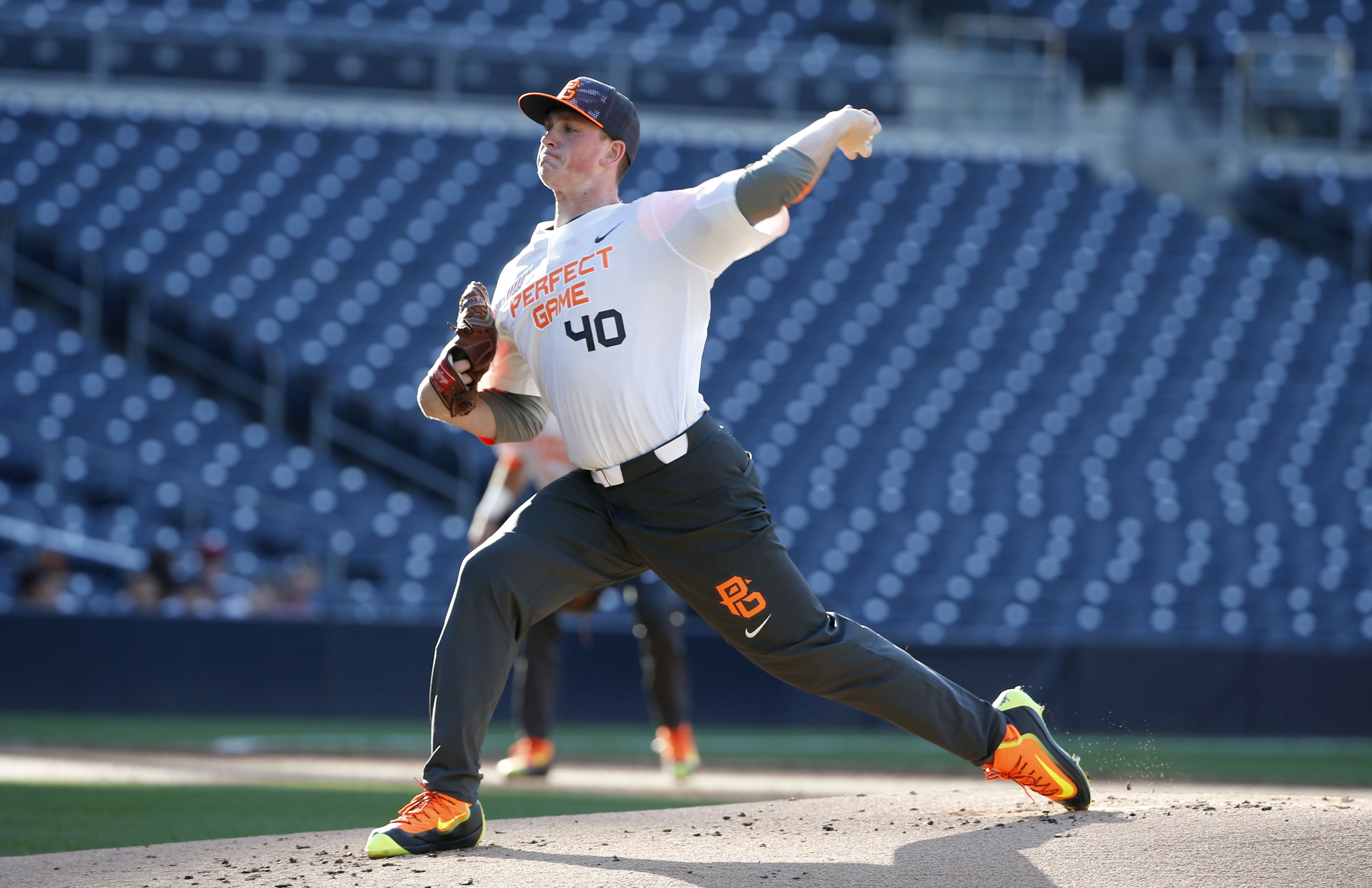 FILE - In this Aug. 16, 2015, file photo, Jason Groome pitches during the Perfect Game All-American Classic high school baseball game, in San Diego. The 17-year-old from Barnegat High School along the New Jersey Shore is 6-foot-5, 225 pounds, throws in the 90s and has a deuce that falls off the table. It's everything baseball scouts want to see, and it's one of the reasons he's considered an early pick in baseball's draft on Thursday night, June 9, 2016. (AP Photo/Lenny Ignelzi, File)